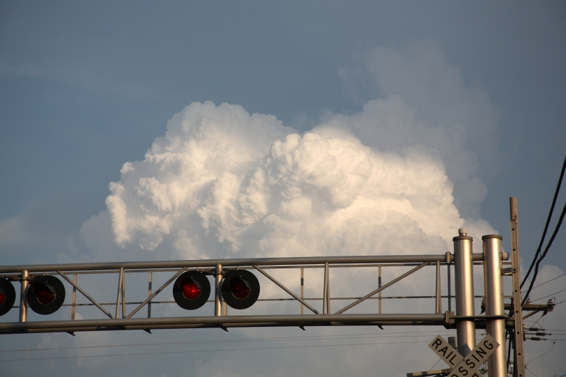 storm cloud at railroad track crossing